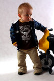 Boy in the studio. Smart boy with motobike toy in the studio having fun Stock Images