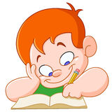 Boy studying. Happy boy writing in a school notebook Royalty Free Stock Photos
