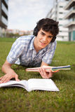 Boy studying. Young boy studying at the park Royalty Free Stock Photo