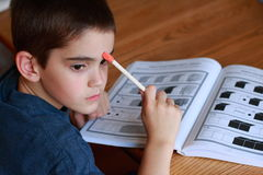 Boy Studying. Young boy studying for school Royalty Free Stock Photo