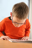 Boy studying. Young student ready for school Royalty Free Stock Image