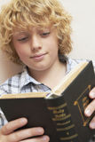 Boy Studying Bible. In bedroom Royalty Free Stock Photo
