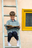 Boy studying book Royalty Free Stock Images