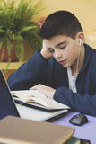 Boy studying book Royalty Free Stock Photography