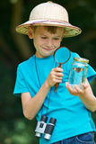 Boy Studying Butterfly Caught In Jar Royalty Free Stock Image