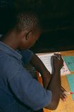 A boy studying in class, Rwanda. A boy studying at a class in Rwanda Royalty Free Stock Images