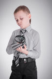 Boy studying his tie Royalty Free Stock Image
