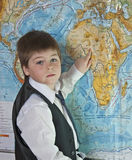 The boy is studying map of the world Royalty Free Stock Photos