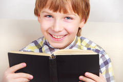 Boy studying the scriptures. Little boy studying the scriptures Royalty Free Stock Photography