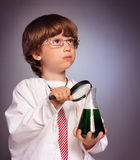 Boy studying a substance in a test tube Stock Image