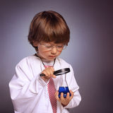 Boy studying a substance in a test tube Royalty Free Stock Photography