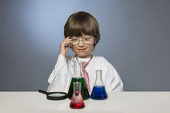 Boy studying a substance in a test tube Royalty Free Stock Image