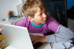 Boy Studying Using Laptop Royalty Free Stock Photography