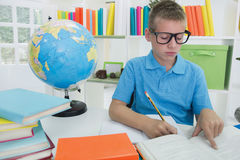 Boy studying Royalty Free Stock Photos