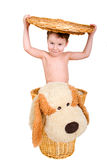 Boy with stuffed animal in the basket Royalty Free Stock Photography