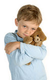 Boy with stuffed animal Stock Images