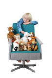 Boy with stuffed animals Stock Images