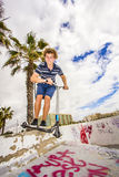 Boy with Stunt Scooter Stock Photography