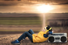 Boy Style Hip-hop, Listening To Vintage Tape Recorder, Lying On A Country Road. Stock Images