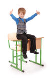 Boy Success. Boy sitting on the school desk Royalty Free Stock Photo