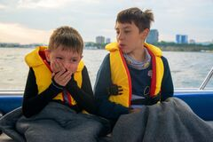 Free Boy Suffers From Seasickness On Board The Boat, Closes His Mouth With His Hands Royalty Free Stock Photos - 169615998