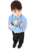 Boy in Suit. Adorable seven year old french american boy in slacks, dress shirt and tie over white background Stock Images