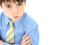 Boy in Suit. Adorable seven year old french american boy in slacks, dress shirt and tie over white background Stock Photo
