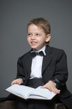 Boy in a suit Stock Image