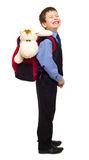 Boy in suit with backpack Royalty Free Stock Photography