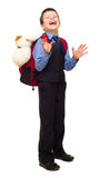 Boy in suit with backpack Royalty Free Stock Photo