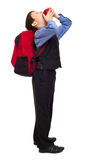 Boy in suit with backpack Stock Image