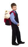 Boy in suit with backpack Stock Photo
