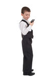 Boy in suit dial on phone Stock Photo