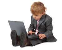 Boy in suit with laptop Royalty Free Stock Images