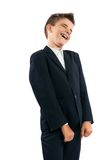 Boy in suit laughs sarcastically Stock Photo