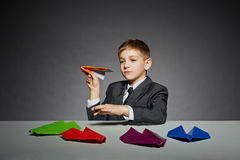 Boy in  suit launching yellow paper plane Stock Images