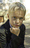 A boy in a suit looks thoughtfully. Royalty Free Stock Photos