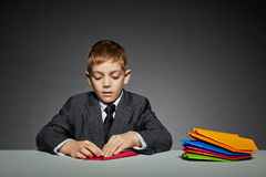 Boy in suit making paper planes Stock Photos