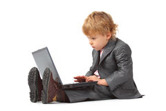 Boy in suit with notebook Stock Images