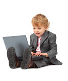 Boy in suit with notebook Stock Photography