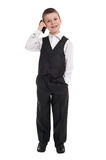 Boy in suit with phone Royalty Free Stock Photos