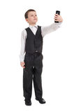 Boy in suit with phone Stock Images
