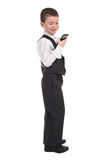 Boy in suit with phone Stock Photo