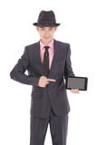 Boy in a suit points to the tablet PC Royalty Free Stock Photo