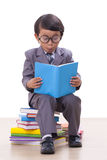 Boy in suit reading a book Royalty Free Stock Images