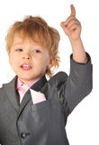 Boy in suit with rised finger Stock Images