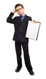 Boy in suit show blank sheet Royalty Free Stock Photos