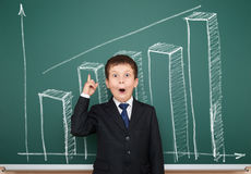 Boy in suit show graphs on school board Stock Photography