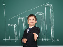Boy in suit show graphs on school board Stock Photos