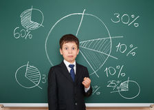 Boy in suit show graphs on school board Stock Image